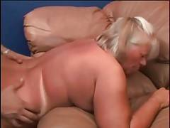 Sluty fat granny is jumping on younger lover`s dong.