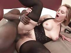 Muscled black guy deeply penetrates mature white slut.
