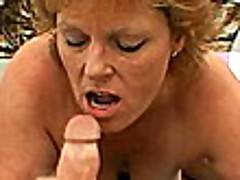 Beauty blonde granny Megan sucking a massive penis with lust on the couch