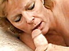 Naughty blonde granny with large tits Megan suck and wank a big shaft
