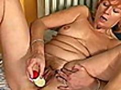 Redheaded granny Lady strips blue lingeria and dildos her hairy muff hard