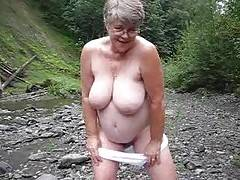 Girdlegoddess has a new pet rock its my cock rock and i do enjoy playing with it Watch me naked out by the creek  hope i dont get caughtor do i
